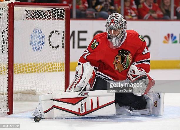 Antti Raanta of the Chicago Blackhawks stops a shot in the second period against the Boston Bruins at the United Center on February 22 2015 in...