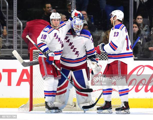 Antti Raanta of the New York Rangers celebrates a 30 win over the Los Angeles Kings with JT Miller and Kevin Hayes at Staples Center on March 25 2017...