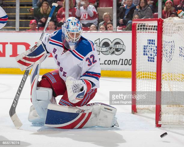 Antti Raanta of the New York Rangers makes a save against the Detroit Red Wings during an NHL game at Joe Louis Arena on March 12 2017 in Detroit...