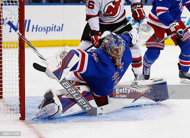 Antti Raanta of the New York Rangers makes a save against the New Jersey Devils during their Pre Season game at Madison Square Garden on September 21...