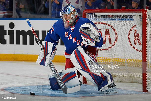 Antti Raanta of the New York Rangers makes a save during pre game warm ups before the game against the San Jose Sharks at Madison Square Garden on...