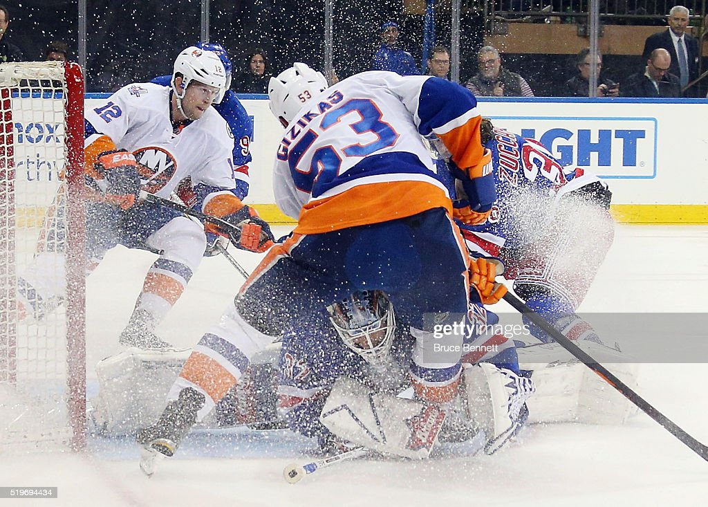 Antti Raanta #32 of the New York Rangers makes the save as Casey Cizikas #53 of the New York Islanders looks for the rebound during the third period at Madison Square Garden on April 7, 2016 in New York City. The Islanders defeated the Rangers 4-1.