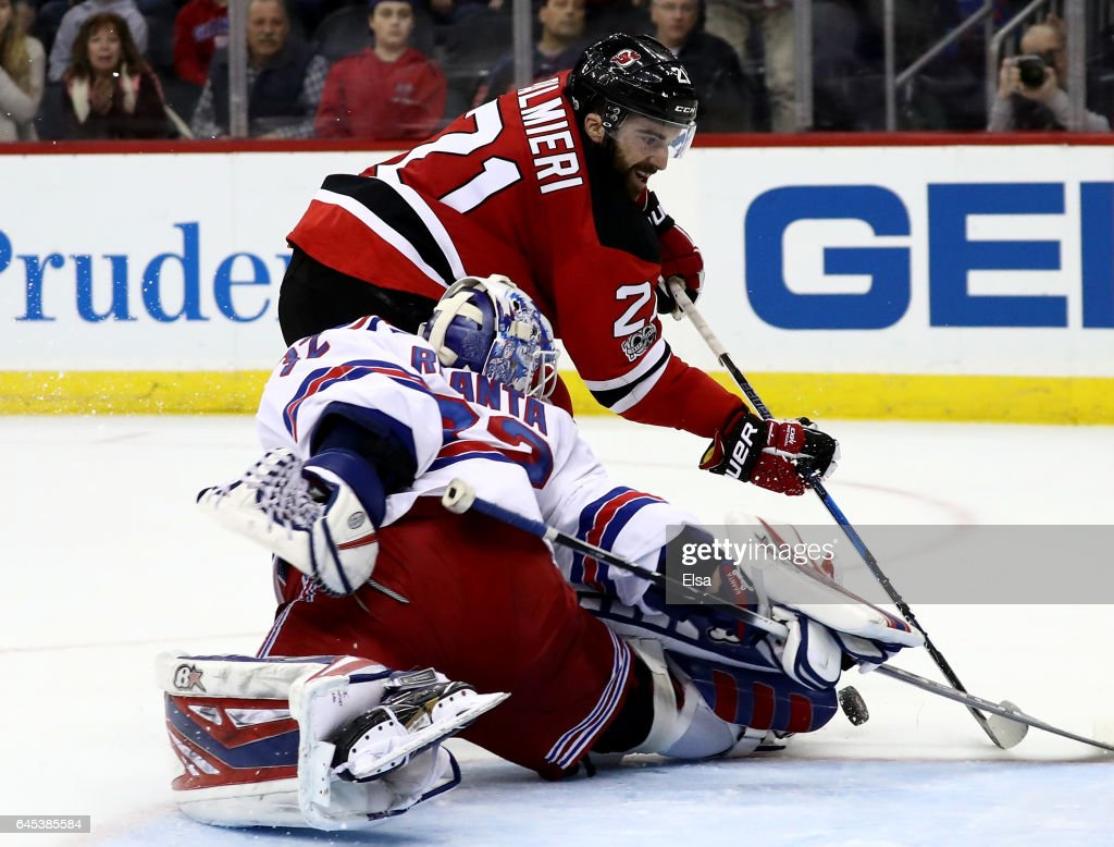 Antti Raanta #32 of the New York Rangers stops a shot by Kyle Palmieri #21 of the New Jersey Devils in the overtime period on February 25, 2017 at Prudential Center in Newark, New Jersey.
