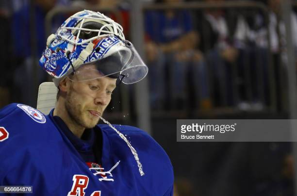 Antti Raanta of the New York Rangers takes a first period water break against the New York Islanders at Madison Square Garden on March 22 2017 in New...