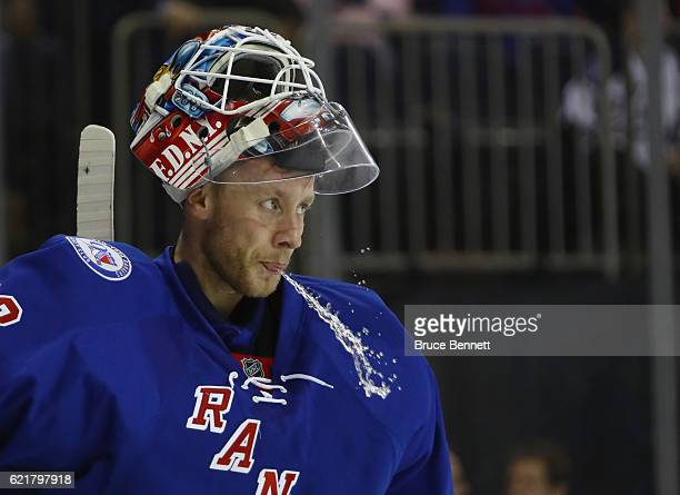 Antti Raanta of the New York Rangers takes a water break during the first period against the Vancouver Canucks at Madison Square Garden on November 8...