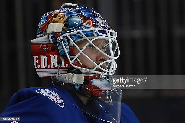 Antti Raanta of the New York Rangers wears a 'FDNY' helmet against the San Jose Sharks during the first period at Madison Square Garden on October 17...