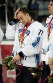 AnttiJussi Niemi of Finland stands with his silver medals after losing 32 to Sweden in the final of the men's ice hockey match between Finland and...