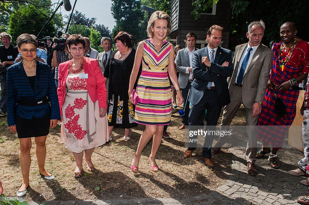Antwerp Province Governor Cathy Berx (L) and Princess Mathilde of Belgium (C) visit on July 16, 2013 the House of Colors, a shelter for youths and children in crisis situations, in Vosselaar.