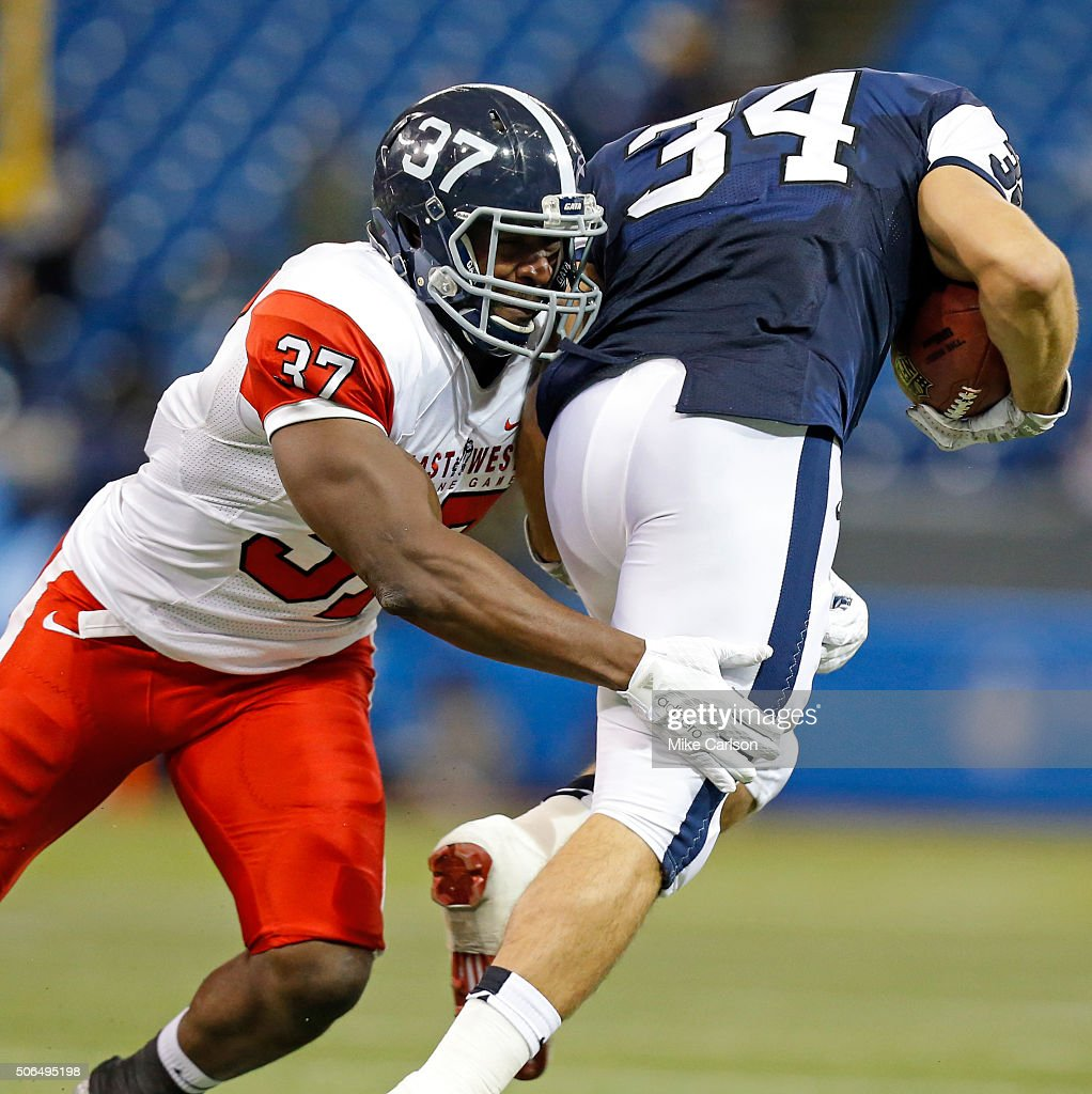 Antwione Willams #37 from Georgia Southern playing on the East Team tackles Derek Watt #34 from Wisconsin playing on the West Team during the second half of the East West Shrine Game at Tropicana Field on January 23, 2016 in St. Petersburg, Florida.