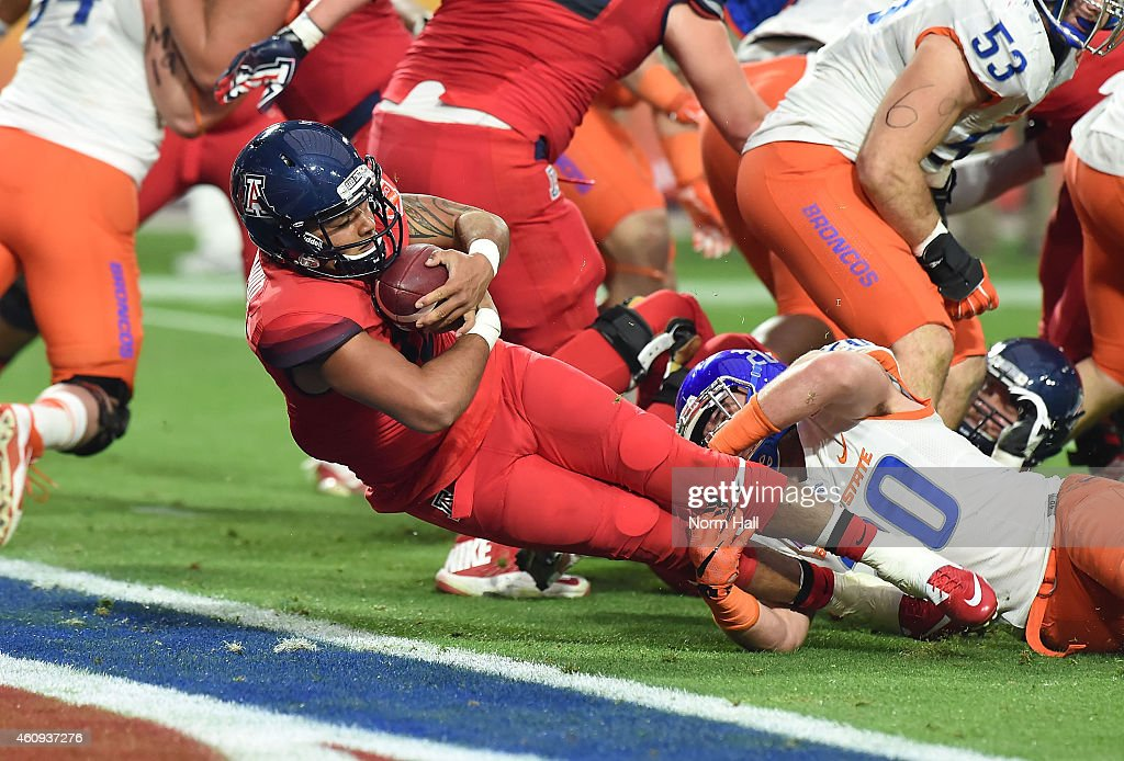 Anu Solomon #12 of the Arizona Wildcats dives into the endzone during the first quarter against the Boise State Broncos at University of Phoenix Stadium on December 31, 2014 in Glendale, Arizona.