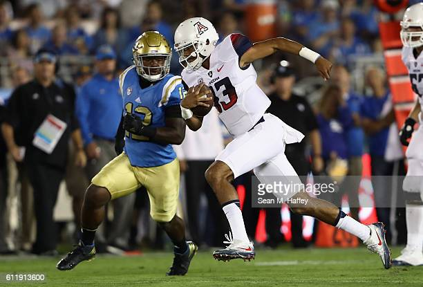 Anu Solomon of the Arizona Wildcats runs past Jayon Brown of the UCLA Bruins during the first half of a game at the Rose Bowl on October 1 2016 in...