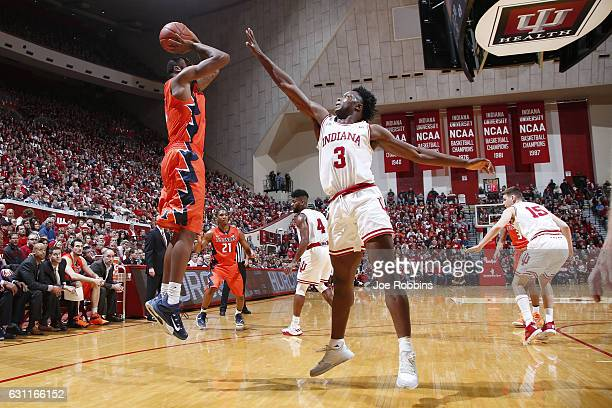 Anunoby of the Indiana Hoosiers defends a shot by Kipper Nichols of the Illinois Fighting Illini in the second half of the game at Assembly Hall on...