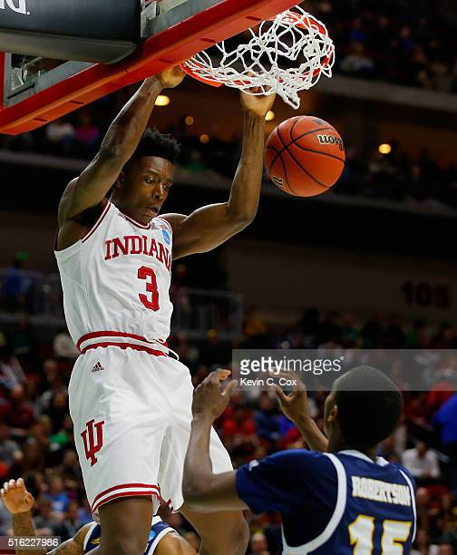 Anunoby of the Indiana Hoosiers dunks against Eric Robertson of the Chattanooga Mocs during the first round of the 2016 NCAA Men's Basketball...