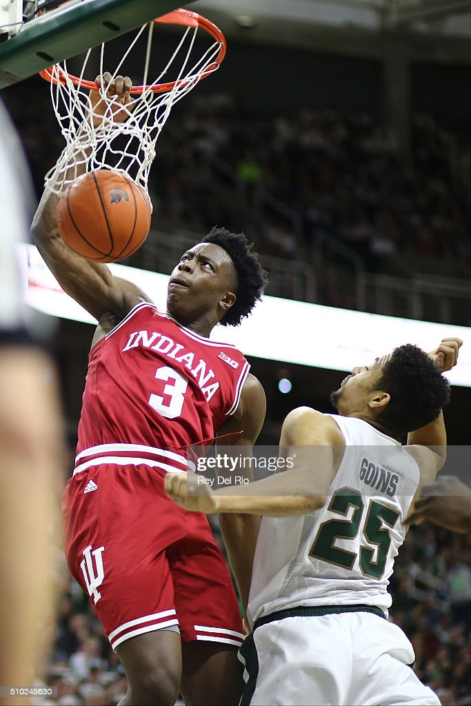 OG Anunoby #3 of the Indiana Hoosiers dunks the ball during the game against <a gi-track='captionPersonalityLinkClicked' href=/galleries/search?phrase=Kenny+Goins&family=editorial&specificpeople=14308517 ng-click='$event.stopPropagation()'>Kenny Goins</a> #25 of the Michigan State Spartans in the first half at the Breslin Center on February 14, 2016 in East Lansing, Michigan.
