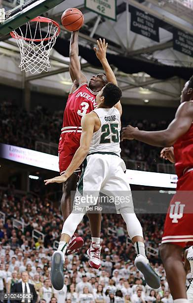 Anunoby of the Indiana Hoosiers dunks the ball during the game against Kenny Goins of the Michigan State Spartans in the first half at the Breslin...