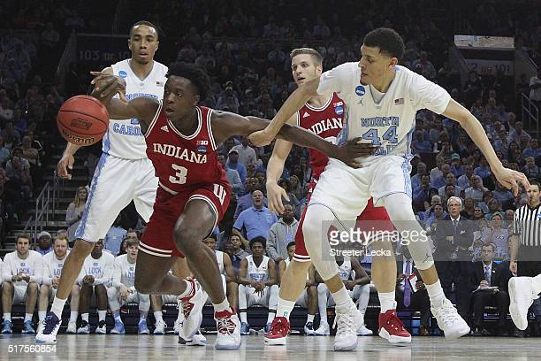 Anunoby of the Indiana Hoosiers fights for the ball against Justin Jackson of the North Carolina Tar Heels during the 2016 NCAA Men's Basketball...