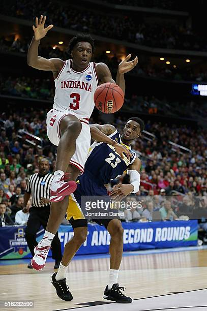 Anunoby of the Indiana Hoosiers loses control of the ball against Tre' McLean of the Chattanooga Mocs in the second half during the first round of...