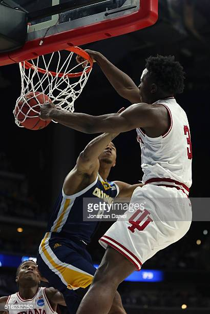 Anunoby of the Indiana Hoosiers shoots a reverse dunk over Chuck Ester of the Chattanooga Mocs in the second half during the first round of the 2016...
