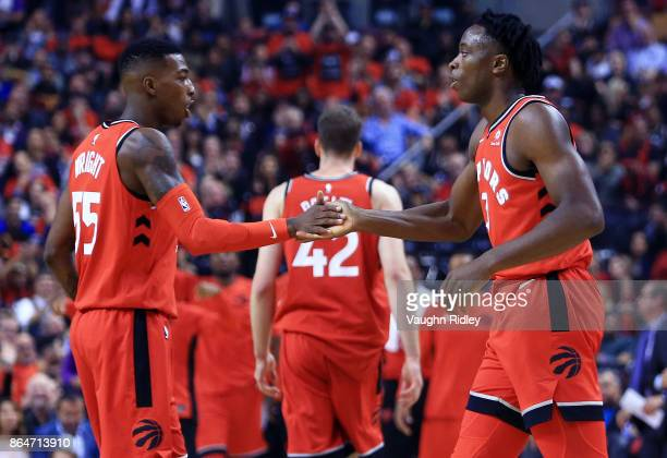 Anunoby of the Toronto Raptors celebrates his first 2 points with Delon Wright during the first half of an NBA game against the Chicago Bulls at Air...