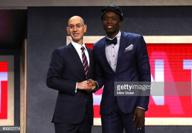 Anunoby walks on stage with NBA commissioner Adam Silver after being drafted 23rd overall by the Toronto Raptors during the first round of the 2017...