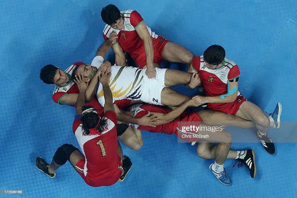 Anup Kumar #2 of Independent Olympic Athletes is tackled by the Iran defence during the Men's Kabaddi Gold Medal match at Ansan Sangnoksu Gym on day five of the 4th Asian Indoor & Martial Arts Games on July 3, 2013 in Incheon, South Korea.