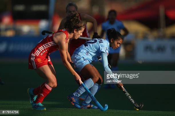 Anupa Barla of India and Anna Toman of England battle for possession during the Quarter Final match between England and India during the FIH Hockey...