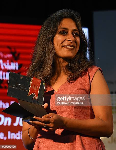 Anuradha Roy author of Sleeping on Jupiter holds her South Asian Literature prize during a literary festival in the southern Sri Lankan town of Galle...