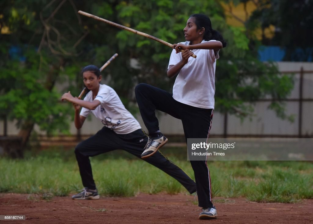 Anushka Mane (Front) and Sakshi Patil (Back) display Single Stick, a type of Silambam, a weapon based Indian Martial arts, on October 4, 2017 in Pune, India. The word Silambam means either a mountain or merely to sound (as verb). While the Silambam fencers are fighting, the weapon makes sound. This might have been the cause for its being named as Silambam.