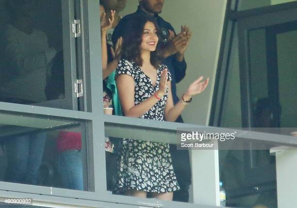 Anushka Sharma girlfriend of Virat Kohli applauds as Virat Kohli celebrates after reaching 50 runs during day five of the Third Test match between...