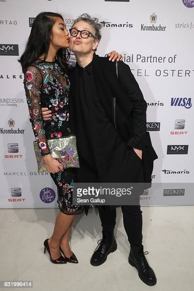 Anuthida Ploypetch and Rolf Schneider attend the Marcel Ostertag show during the MercedesBenz Fashion Week Berlin A/W 2017 at on January 18 2017 in...