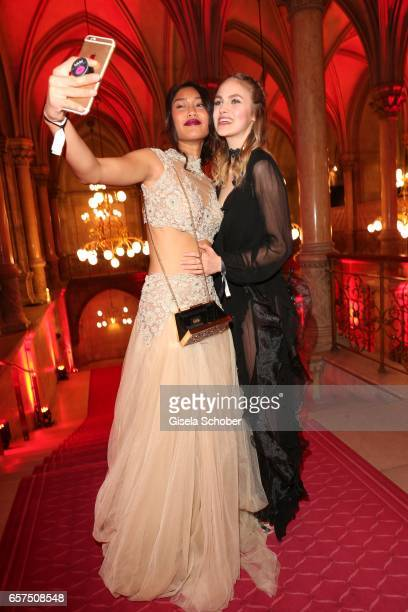 Anuthida Ploypetch gntm and Elena Carriere during the 8th Filmball Vienna at City Hall on March 24 2017 in Vienna Austria