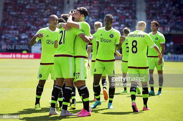 Anwar El Ghazi of Ajax celebrates his 30 against AZ Alkmaar with his teammates in AFAS Stadium in Alkmaar the Netherlands on August 9 2015 AFP PHOTO...