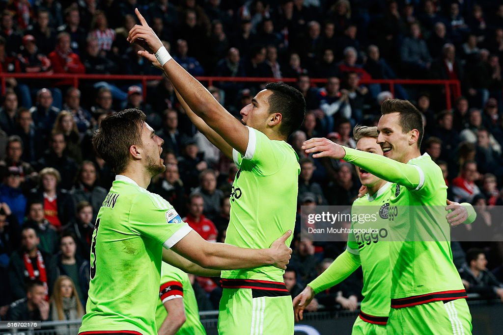 Anwar El Ghazi of Ajax celebrates scoring his teams second goal of the game with team mates during the Eredivisie match between PSV Eindhoven and Ajax Amsterdam held at Philips Stadium on March 20, 2016 in Eindhoven, Netherlands.