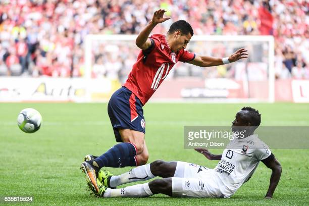 Anwar El Ghazi of Lille and Adama Mbengue of Caen during the Ligue 1 match between Lille OSC and SM Caen at Stade Pierre Mauroy on August 20 2017 in...