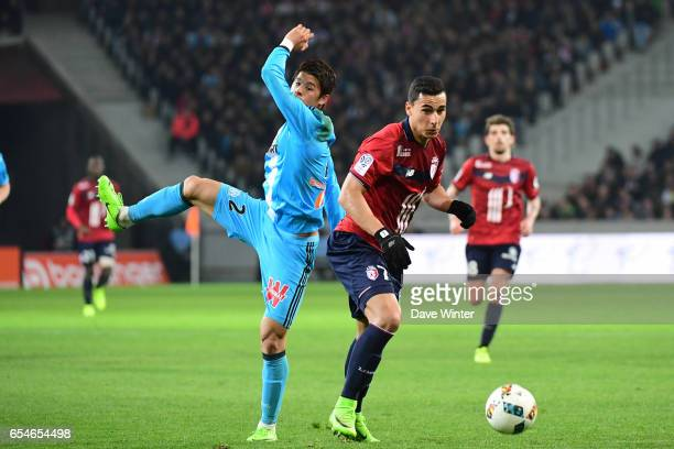 Anwar El Ghazi of Lille and Hiroki Sakai of Marseille during the Ligue 1 match between Lille OSC and Olympique de Marseille at Stade Pierre Mauroy on...