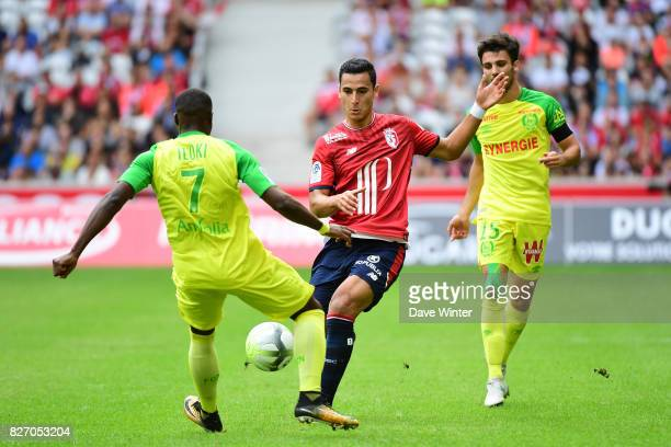 Anwar El Ghazi of Lille and Jules Iloki of Nantes during the Ligue 1 match between Lille OSC and Nantes at Stade Pierre Mauroy on August 6 2017 in...