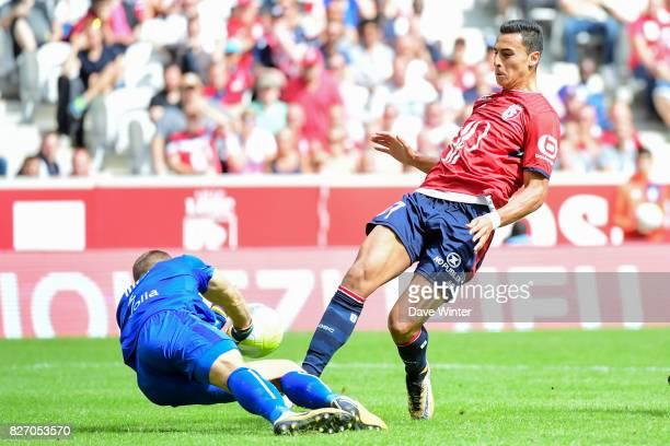 Anwar El Ghazi of Lille is beaten to the ball by goalkeeper Maxime Dupe of Nantes during the Ligue 1 match between Lille OSC and Nantes at Stade...
