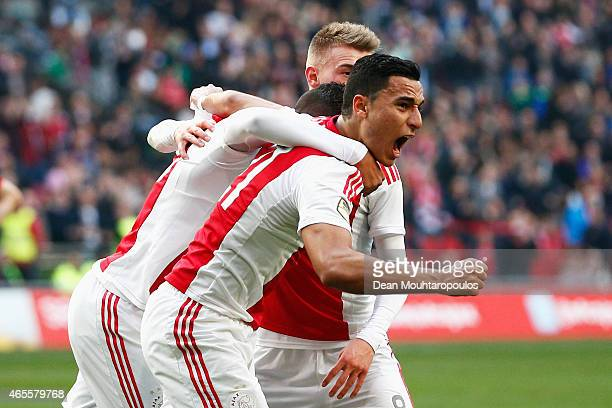 Anwar ElGhazi of Ajax celebrates scoring the first goal of the game with Richairo Zivkovic and Daley Sinkgraven during the Dutch Eredivisie match...