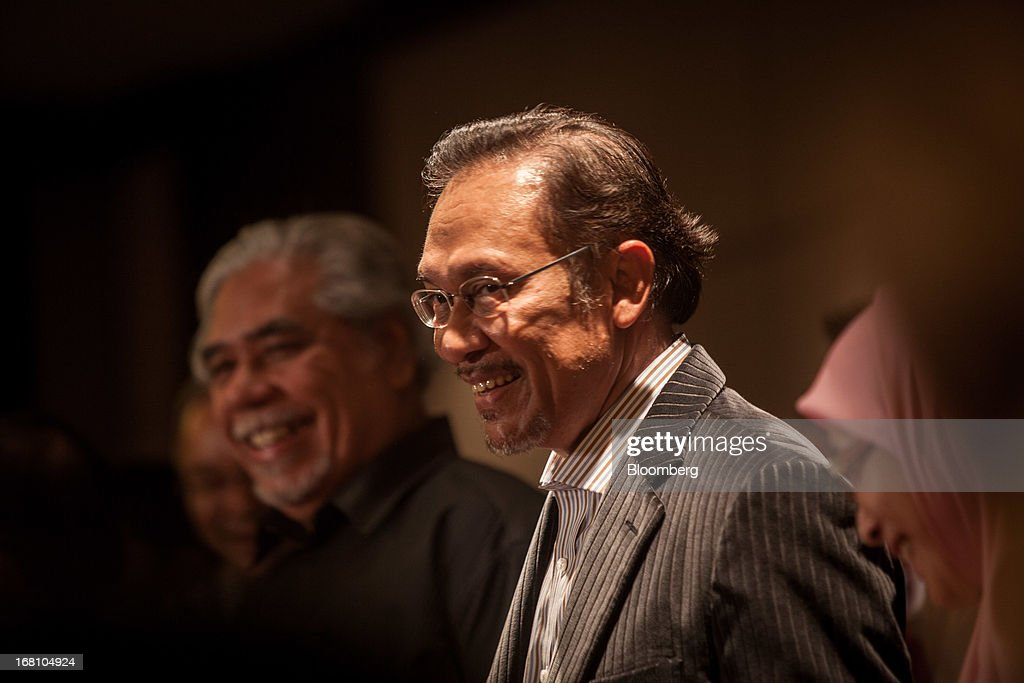 Anwar Ibrahim, Malaysia's opposition leader, smiles during a news conference at the One World Hotel in Kuala Lumpur, Malaysia, on Sunday, May 5, 2013. Malaysia Prime Minister Najib Razak's coalition won a simple majority in the country's election, defeating Anwar Ibrahim's opposition alliance and extending its 55-year hold on power. Photographer: Sanjit Das/Bloomberg via Getty Images
