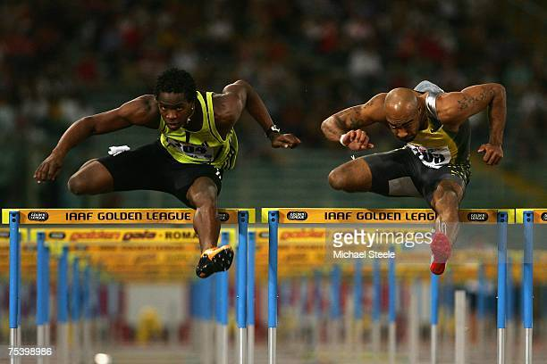 Anwar Moore of USA clears the last hurdle to win the men's 110m hurdles from Dayron Robles of Cuba during the IAAF Golden Gala meeting at the Olympic...