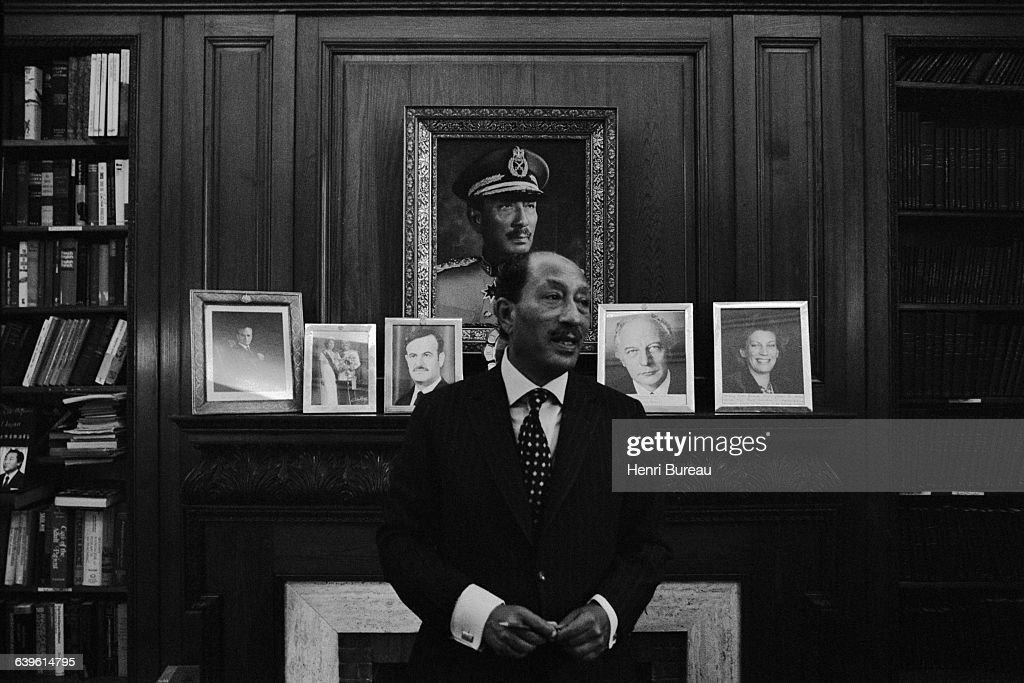 Anwar Sadat, President of Egypt from 1970 to 1981, in his office in Cairo, upon his return from Jerusalem. Behind him are photographs of the Shah of Iran, King Hussein of Jordan and Syrian President Hafez al Assad, among others.