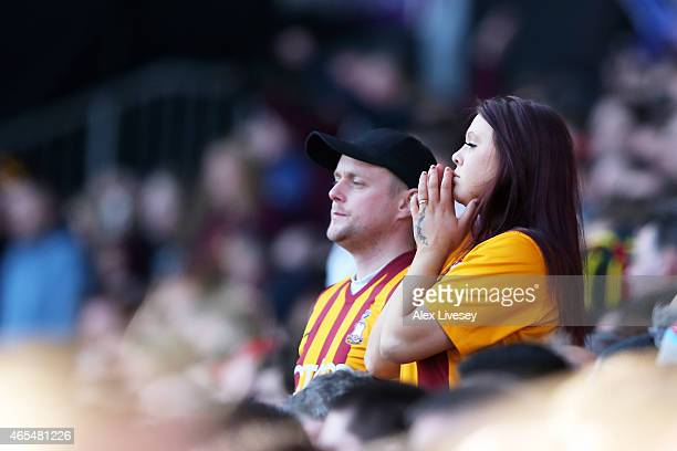 Anxious Bradford fans look on during the FA Cup Quarter Final match between Bradford City and Reading at the Coral Windows Stadium Valley Parade on...