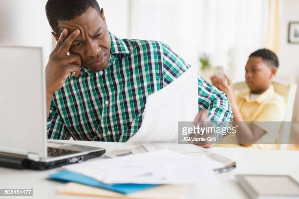 Anxious father paying bills online