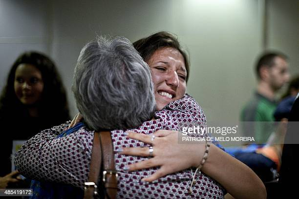 HAGEMANN Anya 16 years old hugs Maria Joao Leitao a member of her host family at the boarding area of Lisbon's Airport on August 16 2015 For Anya a...