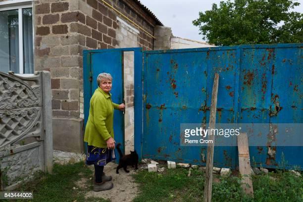 Anya Fendeyeva enters her house on the frontline recently shelled during fightings on September 06 2017 in Avdiivka Ukraine The frontlinecity...