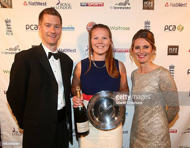 Anya Shrubsole celebrates after winning the Waitrose Womens Player of the Summer award from Waitrose Paul Hogan and Charlotte Edwards during The PCA...