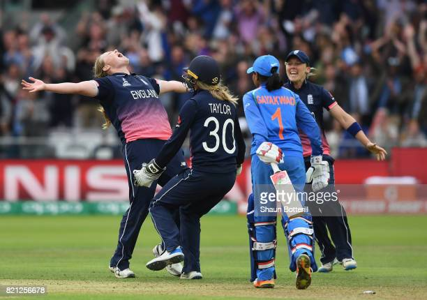 Anya Shrubsole of England celebrates with teammates Sarah Taylor and Heather Knight after taking the final India wicket of Rajeshwari Gayakwad to win...