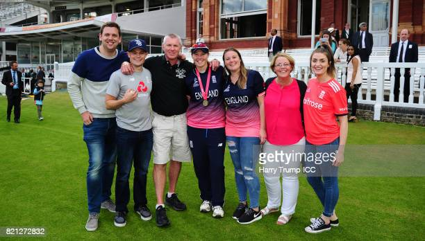 Anya Shrubsole of England poses with her family during the ICC Women's World Cup 2017 Final between England and India at Lord's Cricket Ground on...
