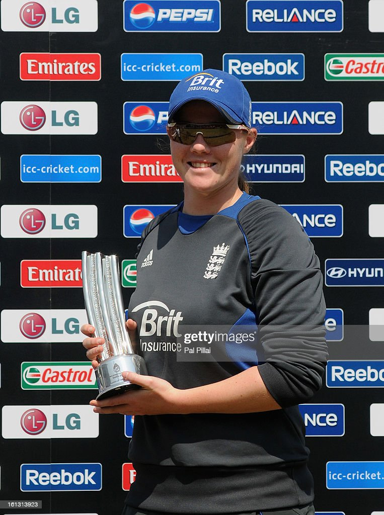 Anya Shrubsole of England poses with the woman of the match trophy during the Super Sixes match between England and South Africa held at the Barabati stadium on February 10, 2013 in Cuttack, India.