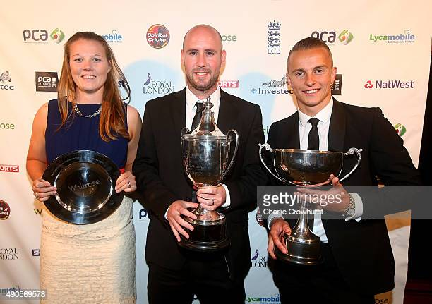 Anya Shurbsole Chris Rushworth and Tom Curran celebrate winning the awards during The PCA Awards at Tobacco Dock on September 29 2015 in London...